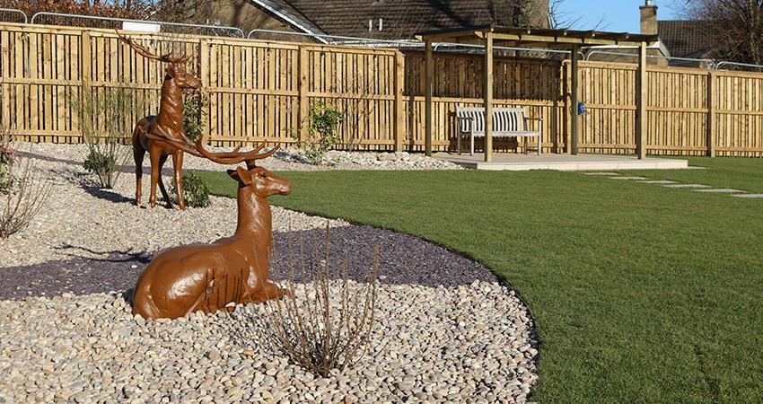Bronze Deer in lovely large garden